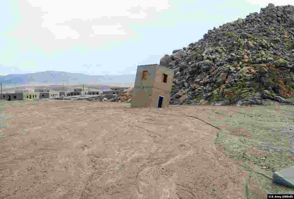 Storms in September 2013 swept through the Fort Irwin site, toppling a Medina Jabal structure filling some of the buildings with up to four feet of mud.