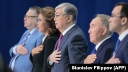 Interim Kazakh president Qasym-Zhomart Toqaev (center) -- flanked on the right by former incumbent Nursultan Nazarbaev and Nazarbaev's eldest daughter, Darigha, on the left -- is not expected to be be seriously challenged in the upcoming election. (file photo)