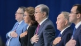 KAZAKHSTAN -- Former Kazakh president Nursultan Nazarbaev, Kazakh interim President Qasym-Zhomart Toqaev and other attendees listen to the national anthem as they attend a congress of the ruling Nur Otan party in Nur-Sultan, April 23, 201