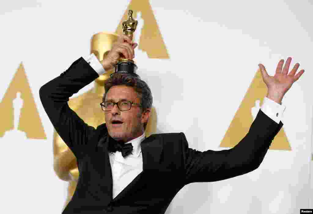 Polish director Pawel Pawlikowski holds his Oscar for best foreign language film for Ida during the 87th Academy Awards ceremony in Hollywood, California, on February 22. (Reuters/​Lucy Nicholson)​