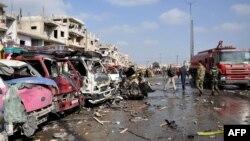 Pamje pas eksplodimeve në Homs të Sirisë