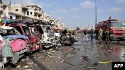 Սիրիա - Երկու պայթյունների հետևանքով վնասված ավտոմեքենաներ Հոմսի ալ-Զահրա արվարձանում, 21-ը փետրվարի, 2016թ․