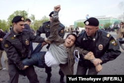 An opposition protester is detained by police in Bolotnaya Square in May 2012.