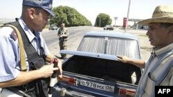 Police check cars for weapons on the road to Ekazhevo in Ingushetia. Militants in the region had announced a moratorium on attacking such rank-and-file members of the police.