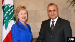 Lebanese President Michel Sleiman shakes hands with U.S. Secretary of State Hillary Clinton during a meeting in Baabda, east of Beirut.