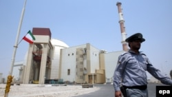 A security officer walks in front of the nuclear power plant in Bushehr, which came online in 2011.