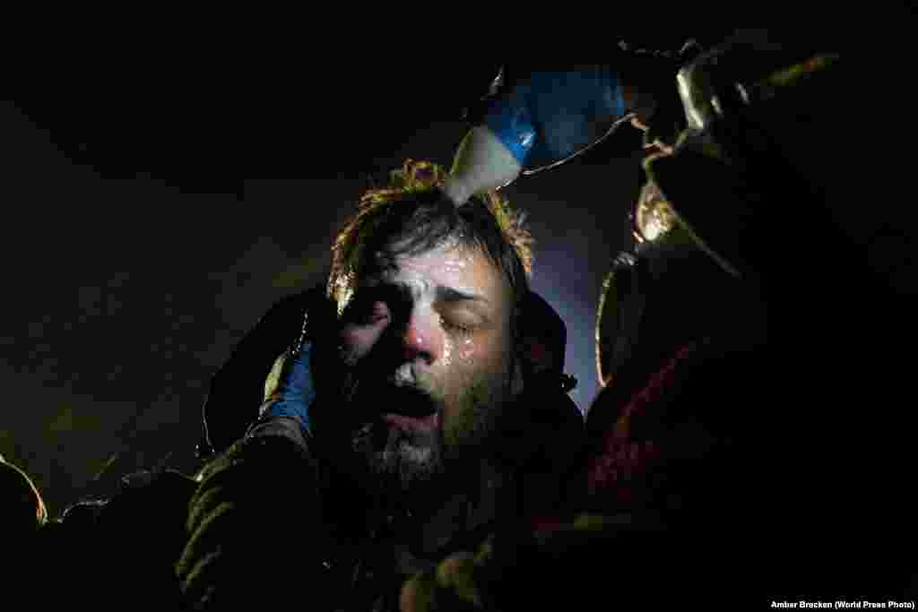 A man is treated with milk of magnesia after being pepper sprayed at a police blockade during the Standing Rock protests near Cannon Ball, North Dakota. Contemporary Issues -- First Prize, Stories (Amber Bracken)