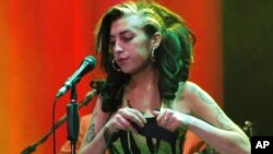 Amy Winehouse on stage during her disastrous last concert, in Belgrade, on June 18.