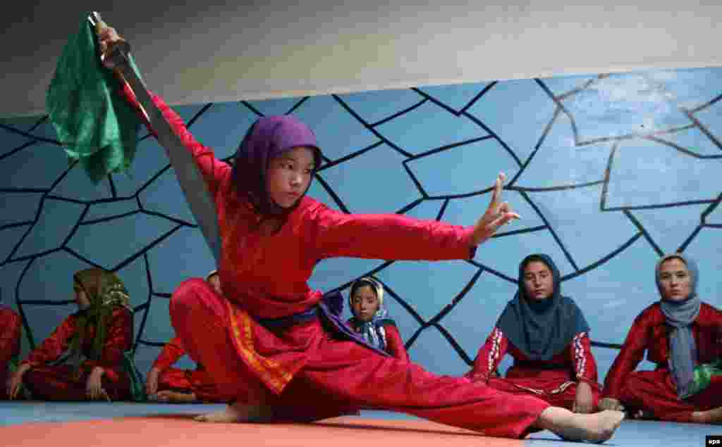 Afghan girls practice martial arts at the Osho Institute in Herat on July 18. (EPA/Jalil Rezayee)
