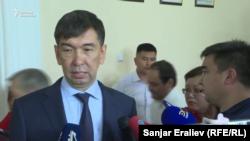 Bishkek's new mayor, Aziz Surakmatov speaking to reporters on August 8.