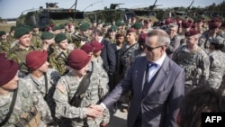 Estonian President Hendrik Ilves greeting U.S. troops in Estonia.