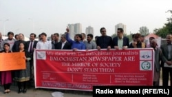 FILE: A journalist protest in the Pakistani capital Islamabad.