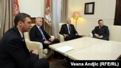 A meeting in late May of newly elected President Tomislav Nikolic (second from left), former President Boris Tadic (second from right) and (right) Ivica Dacic in Belgrade.