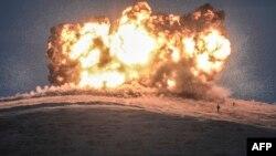 """Взрыв, предположительно организованный боевиками группировки """"Исламское государство"""" на границе Сирии с Турцией. 23 октября 2014 года."""