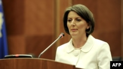Newly elected President Atifete Jahjaga addresses parliament in Pristina on April 7.
