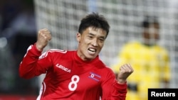 South Africa -- North Korea's Ji Yun-nam celebrates his goal during a 2010 World Cup Group G soccer match at Ellis Park stadium in Johannesburg,15Jun2010