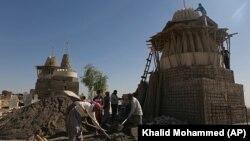Un templu al comunității yazidi din Irak în reconstrucție după eliberarea teritoriului de sub Statul Islamic