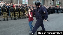 A Russian police officer detains a teenager during a rally protesting increases in the retirement age in St. Petersburg in September.