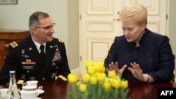 U.S. General Curtis Michael Scaparrotti (left) talks with Lithuanian President Dalia Grybauskaite in Vilnius on March 16.