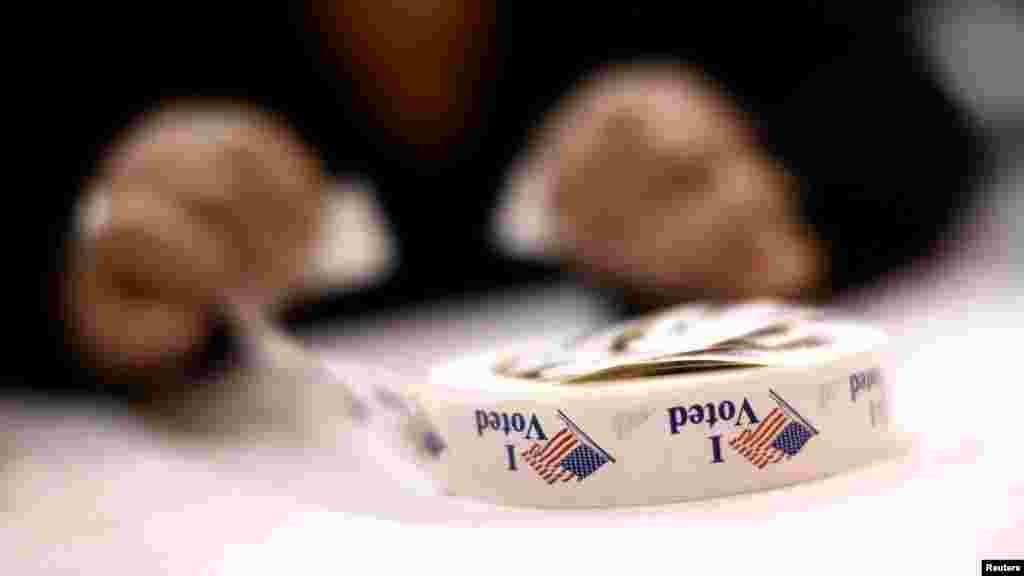 A poll worker prepares 'I Voted' stickers at Harrison United Methodist Church in Pineville, North Carolina.