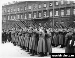 New recruits fire a volley into the air after swearing allegiance to the Red Army.