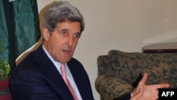 Pakistan -- US senator John Kerry speaks to media representatives during a news conference in Lahore, 15Feb2011