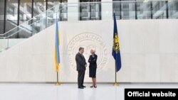 Президент України Петро Порошенко і директор-розпорядник МВФ Крістін Лаґард. Вашингтон, 20 червня 2017 року