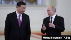 Russian President Vladimir Putin talks with his Chinese counterpart, Xi Jinping, at the Kremlin in Moscow on June 5.