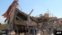 Разрушенный в результате бомбардировки госпиталь в Сирии.