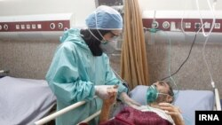 Coronavirus patient with nurse in Iran
