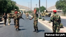 Afghan security forces arrive at the site of an explosion in Kabul on July 1.