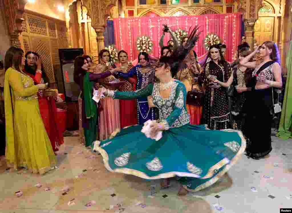 Members of the transgender community attend a birthday party in Peshawar. Armed police guarded the door. Transgender people in Pakistan run the risk of violence in the conservative Muslim country, where they often work as dancers at weddings and other parties but are rarely allowed to hold their own celebrations. (Reuters/Caren Firouz)