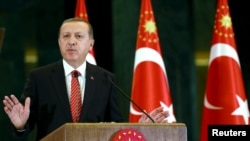 "Turkish President Recep Tayyip Erdogan: ""No one has the right to engage in slander against Turkey."""