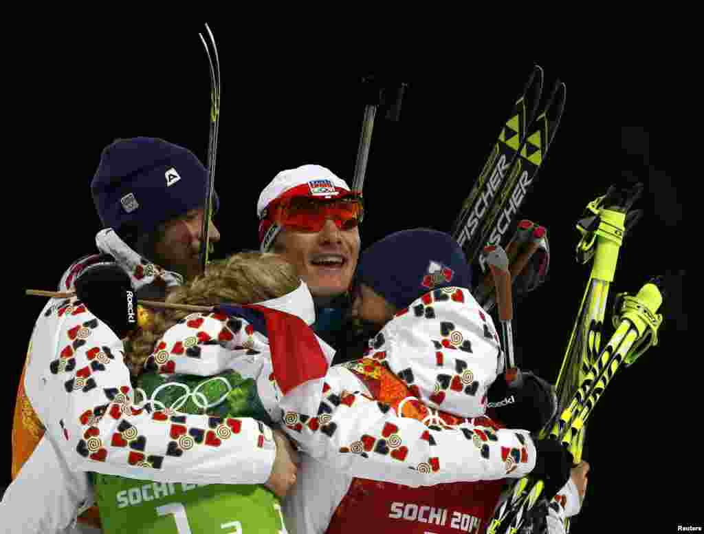 (Left to right:) Silver medal winners Jaroslav Soukup, Gabriela Soukalova, Ondrej Moravec, and Veronika Vitkova of Czech Republic celebrate after completing the mixed biathlon relay. (Reuters/Stefan Wermuth)