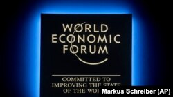 A Forum's logo shines during the annual meeting of the World Economic Forum in Davos, January 23, 2018