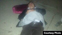 """Избитый неизвестными адвокат Икрамидин Айткулов. Фото взято с профиля Хансара Айткулова в """"Фейсбуке"""". 13 ноября 2013 года"""