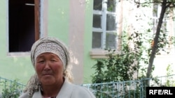 This woman is living by herself on a street in the ethnic Uzbek Cheremushky neighborhood of Osh.