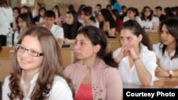 Armenia - a photo of Armenian graduate pupils at an exam, 24May2010