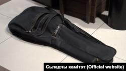 Balta və motorlu mişar gitara qabında olub