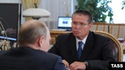 Алексей Улюкаев во время встречи с президентом России Владимиром Путиным. 2013 год