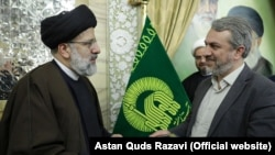 Iran -- Ebrahim Raisi, then-chairman of Astan Quds Razavi, and Seyed Reza Fatemi Amin, undated.