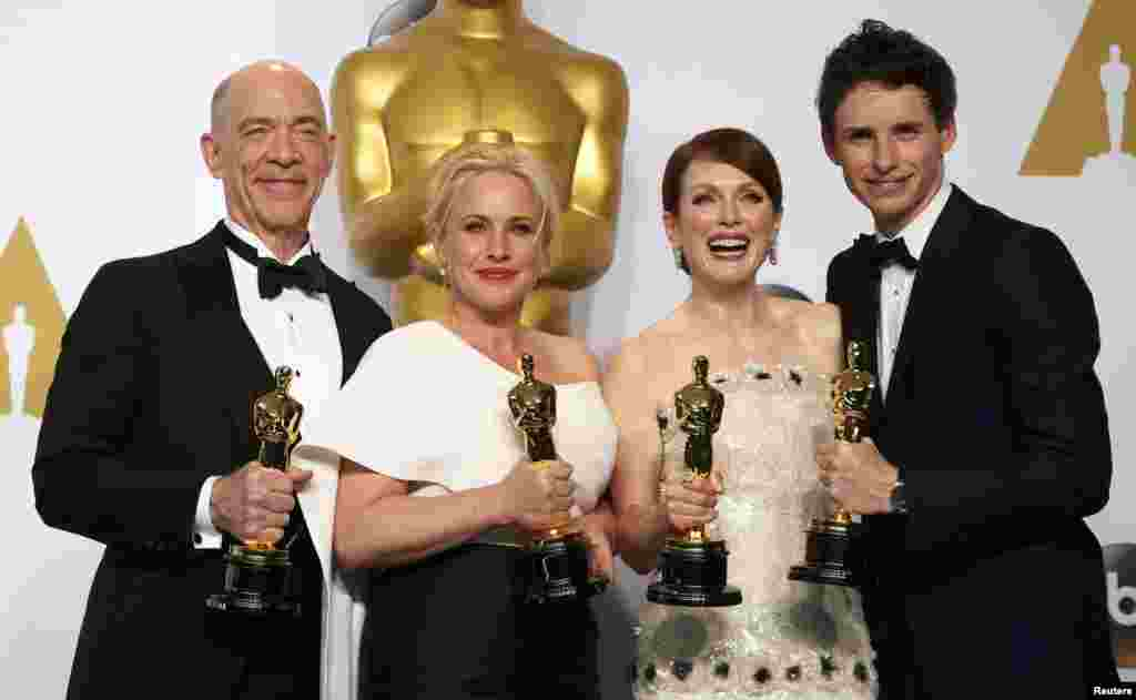 Winners pose for a group pic - from left to right: J.K. Simmons (Best Supporting Actor for Whiplash), Patricia Arquette (Best Supporting Actress for Boyhood), Julianne Moore and Eddie Redmayne.
