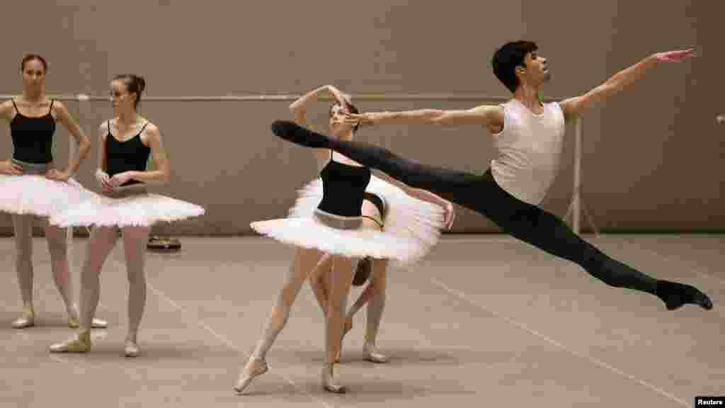 Mario Labrador (right) from California takes part in a lesson at the Bolshoi Ballet Academy in Moscow. (REUTERS/Denis Sinyakov)