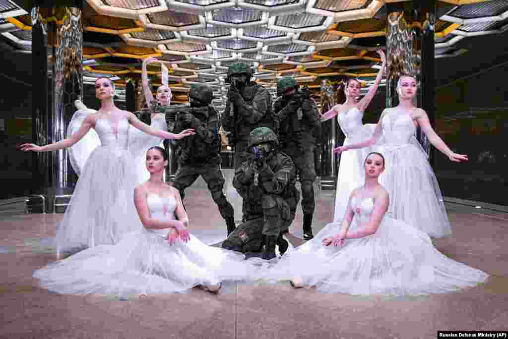 Soldiers and ballerinas pose for pictures during a photo shoot in Yekaterinburg, Russia, to mark International Women's Day. While International Women's Day is marked on March 8 across many countries with calls for gender equality, in Russia it is still a holiday largely focused on celebrating outdated gender roles. (Russian Defense Ministry Press Service via AP)