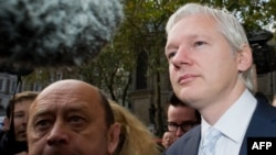 WikiLeaks founder Julian Assange (right) wants Britain's Supreme Court to take up his extradition case.