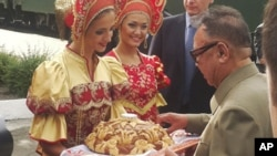 North Korean leader Kim Jong Il is welcomed with bread and salt in front of his armored train upon arrival at the Bureya railway station in eastern Siberia on August 21.