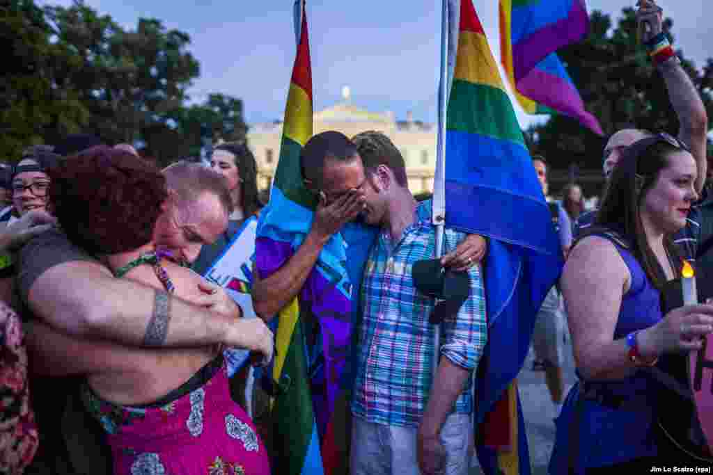 Members of the lesbian, gay, bisexual, and transgender (LGBT) community and their supporters attend a candlelight vigil outside the White House in Washington to honor the victims of a mass shooting at Pulse, a gay nightclub in Orlando, Florida, on June 12. A gunman killed 49 people and wounded 53 before he was shot dead by police. (epa/Jim Lo Scalzo)