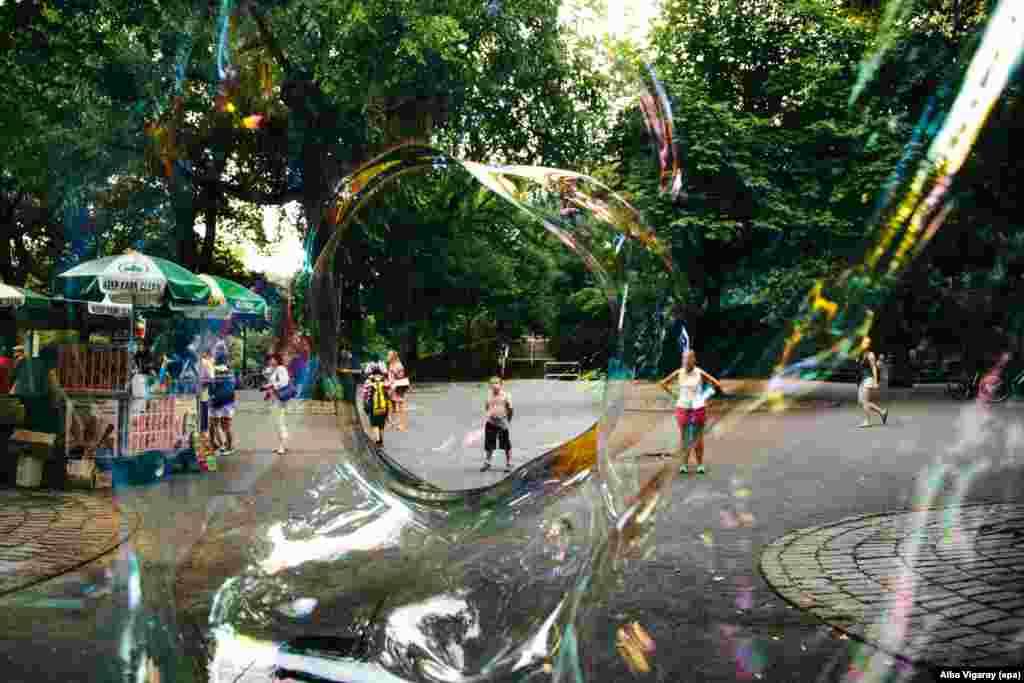 A boy can be seen through a giant soap bubble in Central Park in New York. (epa/Alba Vigaray)