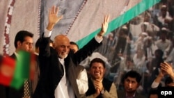 Afghan President-elect Ashraf Ghani waves to supporters during a ceremony in Kabul on September 22.