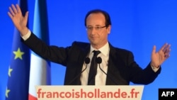 Франсуа Олланд выступает перед своими сторонниками в Тюле, после оглашения первых результатов выборов. Франция, 6 мая 2012 года.